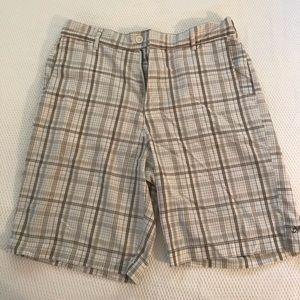 White and khaki checkered shorts